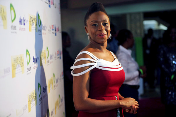 """Chimamanda Ngozi Adichie at the premiere, in Lagos, Nigeria, of the film """"Half of a Yellow Sun,"""" based on her novel. AKINTUNDE AKINLEYE / REUTERS"""