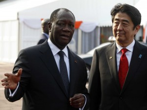 Ivory Coast's President Alassane Ouattara (L) talks with Japanese Prime Minister Shinzo Abe at the presidential palace in Abidjan January 10, 2014.