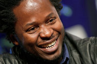"Ishmael Beah, the author of a memoir about the Sierra Leone civil war and now a novel, ""The Radiance of Tomorrow."" MARK LENNIHAN / ASSOCIATED PRESS"