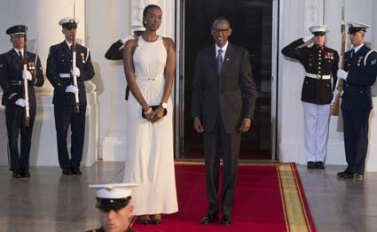 Rwanda President Paul Kagame and daughter arrive at the White House for a group dinner during the US Africa Leaders Summit August 5, 2014 in Washington, DC. AFP/PHOTO