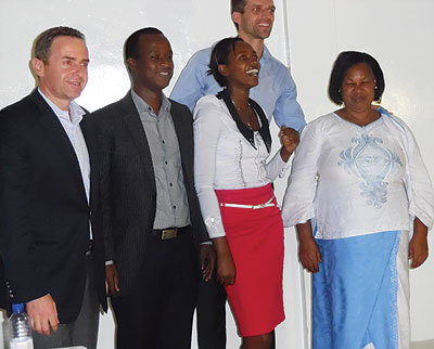 Umutoni (second right) poses with judges after the competition on Thursday. Emmanuel Ntirenganya.