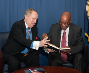 National Press Club President Myron Belkind hands a pen to South African President Jacob Zuma as Zuma prepares to sign the speaker's guest book. Photo/Image: Al Teich