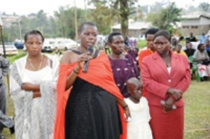 Gloria Tumwijuke (with microphone), Alice Ngonzi Isoke (folding hands in red dress), Diana Alinaitwe (behind Alice), Mrs Isoke (Alice's mother), an unidentified health worker(on Gloria's right) and a granddaughter to Mrs Isoke – all Ebola survivors narrating their ordeal at Kagaadi Hospital during the function to officially declare Uganda Ebola free. Photo courtesy WHO -
