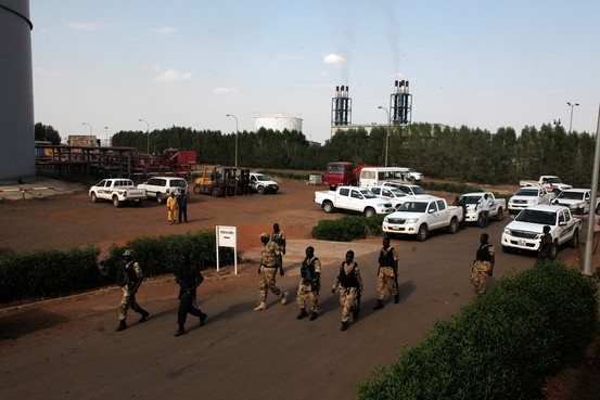 The richest oil fields in South Sudan's Unity and Upper Nile states remain mired in conflict. Shown, soldiers walk past the Paloch oil-field facility in Upper Nile State in March. Reuters