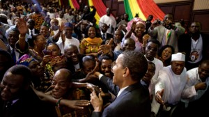 U.S. President Barack Obama shakes hands with the audience after making a speech to the Ghanian parliament during his visit to the country in 2009. The U.S.-Africa Leaders Summit that will be held from Aug. 4-6 in Washington, D.C. will build on Obama's trip to Africa in June 2013. Photo by: Pete Souza / White House