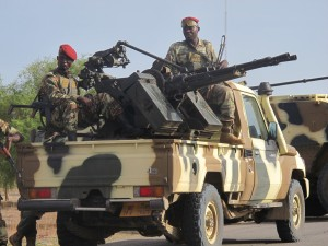 This photo taken on June 17, 2014 shows Cameroonian soldiers standing next to pick up trucks with mounted heavy artillery in Mora, northern Cameroon, which houses a miltiary base where human and logictical resources have been mobilised to face armed Islamist group Boko Haram. Boko Haram, which in April 2014 kidnapped more than 200 schoolgirls in northeast Nigeria to international condemnation, has been waging a brutal, five-year insurgency that has claimed thousands of lives. AFP PHOTO / REINNIER KAZE (Photo credit should read Reinnier KAZE/AFP/Getty Images)