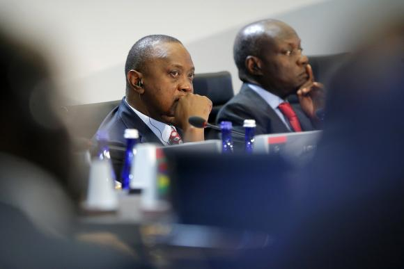Kenya's President Uhuru Kenyatta listens to opening remarks at the start of the U.S.-Africa Leaders Summit Session One on 'Investing in Africa's Future', at the U.S. State Department in Washington August 6, 2014. Also pictured is Guinea-Bissau's President Jose Mario Vaz (R). CREDIT: REUTERS/JONATHAN ERNST L