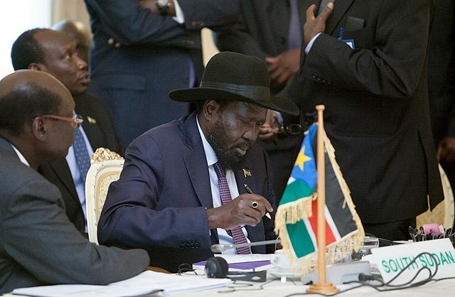 "•South Sudanese President Salva Kiir signs the ""statement of principles"" for the negotiations regarding the national unity government of South Sudan during the 27th Extraordinary Summit IGAD Heads of State. PHOTO/AFP"