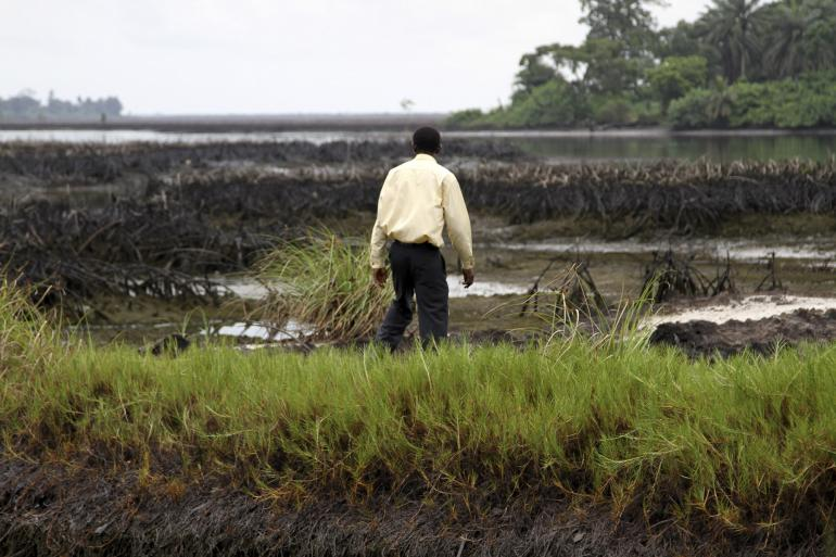 A man walks near a polluted site in Bodo village in Ogoni, Nigeria's Delta region, Sept.10, 2013. REUTERS/Stringer