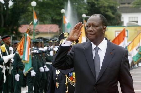 Ivory Coast's President Alassane Ouattara salutes during a parade to commemorate the country's 54th Independence Day, outside the presidential palace in Abidjan August 7, 2014. REUTERS/Luc Gnago.