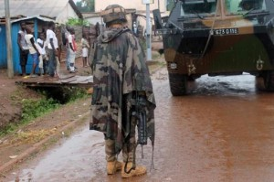 French soldiers from the European Union's Eufor mission patrol in a street of the PK5, the last remaining Muslim district in Bangui on August 21, 2014