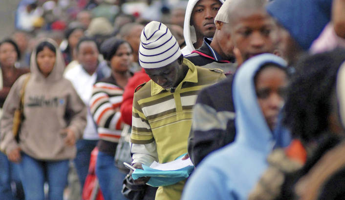 Thousands of hopeful job applicants queue for 200 positions advertised by the Metro Police Department in Durban September 9, 2009. Unemployment figures in South Africa for the second quarter of 2009 stand at 23.6 percent, according to official government statistics. REUTERS/Rogan Ward