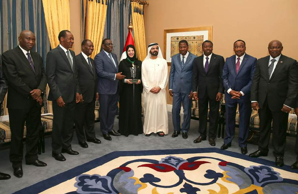 This handout photo made available by Dubai Media Office shows the UAE Vice President, Prime Minister and Ruler of Dubai, Sheikh Mohammed bin Rashid Al Maktoum, center, and Reem Ebrahim Al Hashimi, Minister of State, on his left, as they receive the Presidents and the presidential delegations from the eight UEMOA nations: Benin, Burkina-Faso, Cote d'Ivoire, Guinea- Bissau, Mali, Niger, Senegal, and Togo at the West African Investment Forum in Dubai, United Arab Emirates, Tuesday, Sept. 9, 2014. (AP Photo/Dubai Media Office)