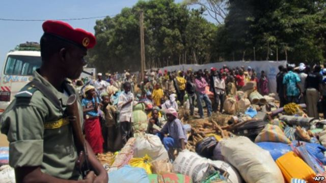 FILE - Refugees from Central Africa Republic wait for a food distribution at an UNHCR refugee camp in the eastern Cameroonian city of Garoua-Boulai, not far from the border with Central Africa Republic, March 13, 2014.