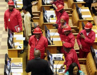 Members of the EFF leading a demonstration in parliament after Jacob Zuma refused to payback millions stolen from the public and spent on his mansion