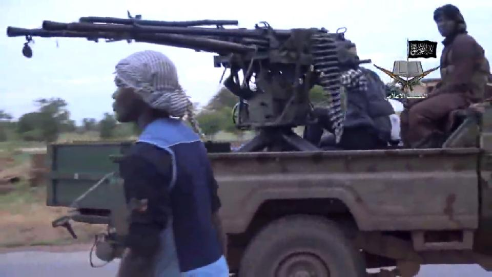 A screengrab taken on August 24, 2014 from a video released by the Nigerian Islamist extremist group Boko Haram shows alleged Boko Haram members at an undisclosed location (AFP Photo/)