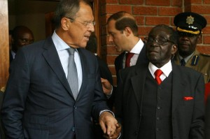 Russian Foreign Minister Sergei Lavrov (L) and Zimbabwean President Robert Mugabe shake hands after a meeting in Zvimba, Zimbabwe, on September 16, 2014 (AFP Photo/Jekesai Njikizana)