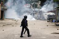 """A riot policeman faces opposition protesters through a could of tear gas in Democratic Republic of Congo""""s capital Kinshasa. In file photo.  REUTERS/Emmanuel Braun"""