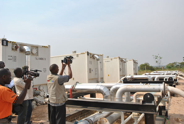 A journalist films oil pipes in Buliisa District in 2012. PHOTO BY Martin Ssebuyiira