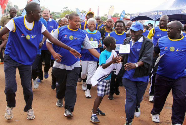 Former Tanzania president Ali Hassan Mwinyi (grey-haired) and other participants finish their race during the Cancer Run at Kololo Ceremonial grounds yesterday. More than Shs300 million was collected from the run to help complete the cancer ward at Nsambya hospital. Photo by Ismail Kezaala.