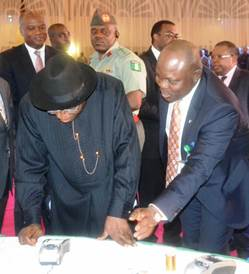 Nigerian President Goodluck Jonathan receives his National eID card, signaling the start of Africa's largest financial inclusion program