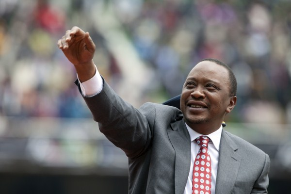 Kenyan president Uhuru Kenyatta waves to the crowd as Kenya celebrates 50 years of independence in Nairobi, Kenya, Dec. 12, 2013 (AP photo by Sayyid Azim).