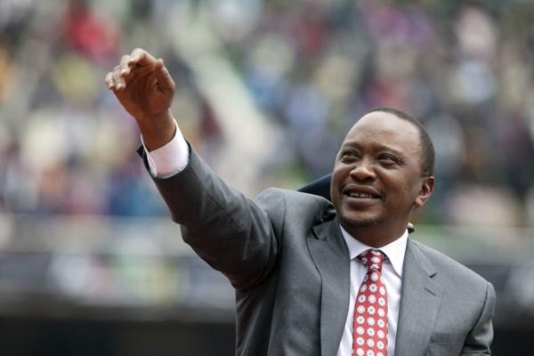 Kenyan president Uhuru Kenyatta waves to the crowd as Kenya celebrates 50 years of independence in Nairobi, Kenya, Dec. 12, 2013 (AP photo by Sayyid Azim).