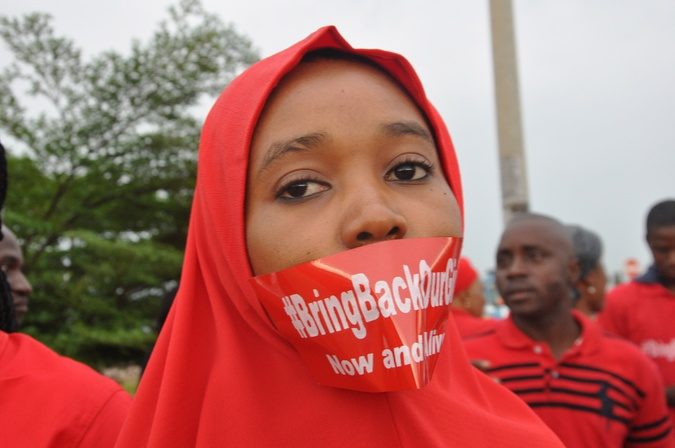A woman attends a demonstration in Abuja, Nigeria, Thursday Sept. 11, 2014, calling on the government to rescue the kidnapped girls of the government secondary school in Chibok.  (AP PHOTO/OLAMIKAN GBEMIGA)