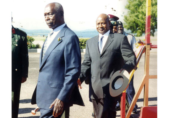 Mr Moi with President Museveni when he visited Uganda in the late 1990s. File photo