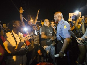 the-ferguson-protests-are-extraordinarily-calmer-after-the-governor-put-a-black-police-captain-in-charge