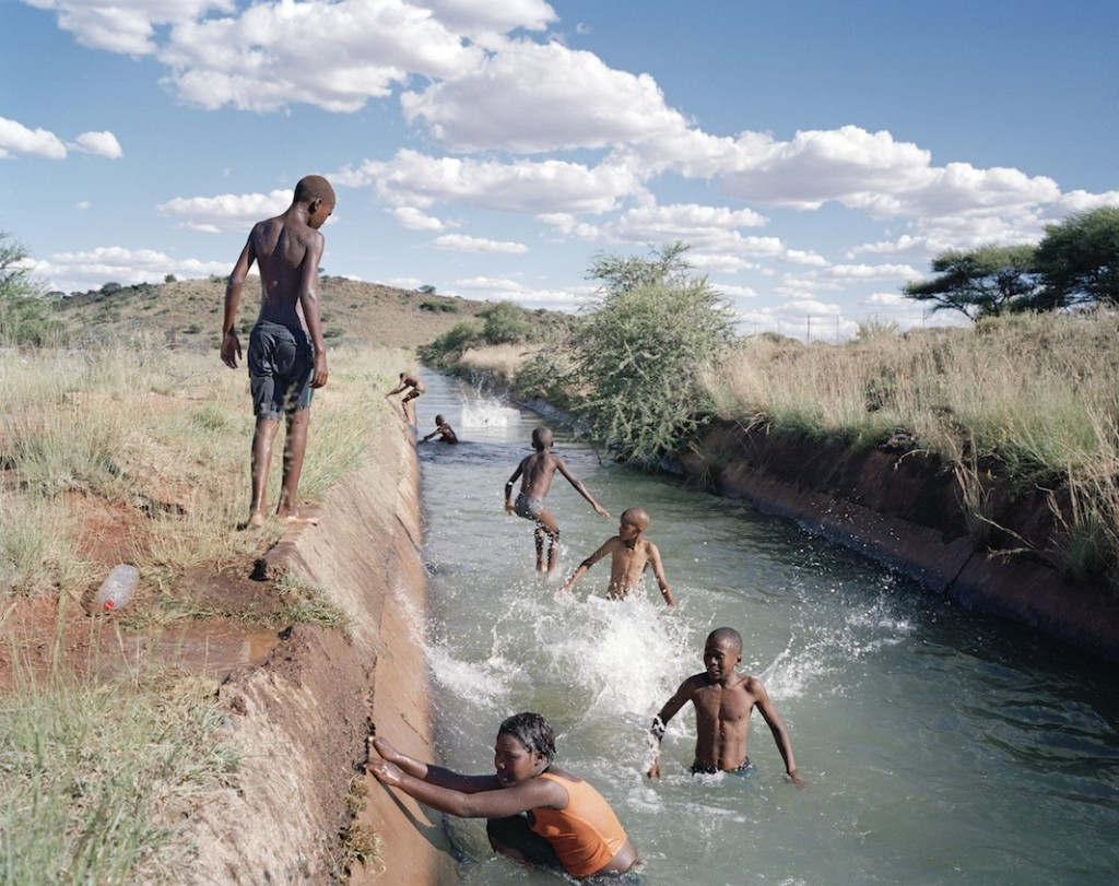 """The suburb of Diamanthoogte is on the outskirts of the diamond mining town of Koffiefontein in the Free State province. During the summer, children enjoy swimming in the canals, which they refer to as the """"Long Sea."""" The canals carry the overflow of water through the town from Kalkfontein Dam and the mine dam to outlying farms."""
