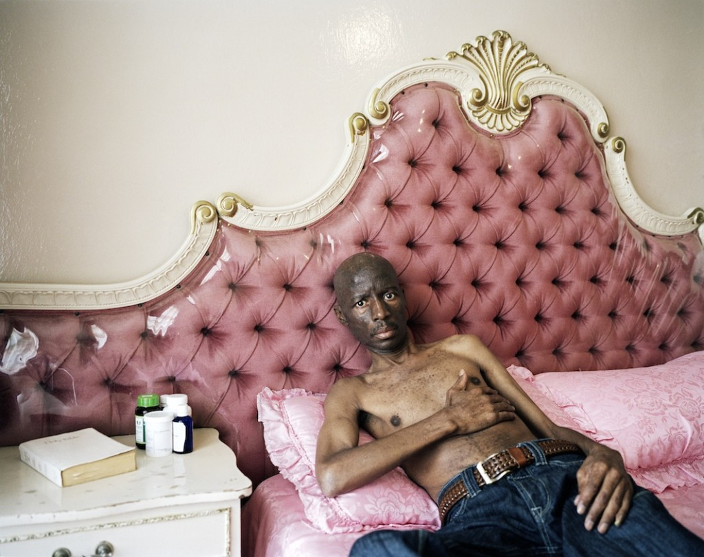 Former miner Mahlomola William Melato rests during the heat of the day at his home in Oppenheimer Park. After being diagnosed with silicosis, Mahlomola suffered from shortness of breath, a debilitating cough, general body weakness, and discoloration of the skin. He died last year.