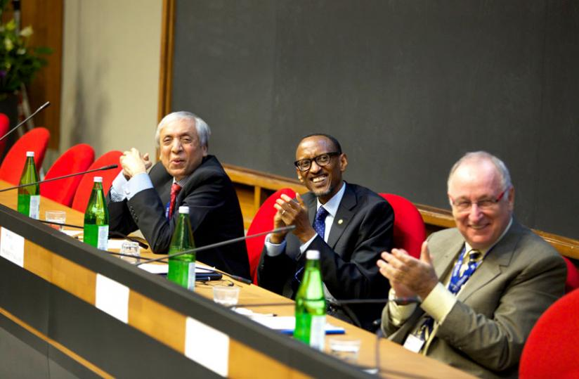 President Kagame, Ansar Parvez, the chairperson of Pakistan Atomic Energy Commission (L), and Luciano Maiani, chairperson of ICTP Scientific Council, follows proceedings at ICTP in Trieste, Italy, yesterday. (Village Urugwiro)