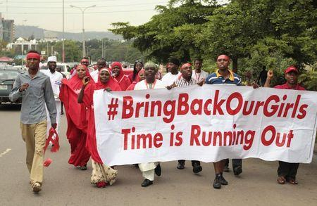 """Campaigners from """"#Bring Back Our Girls"""" march during a rally calling for the release of the Abuja school girls who were abducted by Boko Haram militants, in Abuja October 17, 2014. REUTERS/Afolabi Sotunde"""