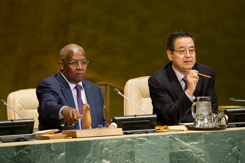General Assembly President Sam Kutesa (left), and Zhang Saijin, Deputy Director of the General Assembly and Economic and Social Council (ECOSOC) Affairs Division, preside over a meeting on the New Partnership for Africa's Development (NEPAD). UN Photo/Rick Bajornas