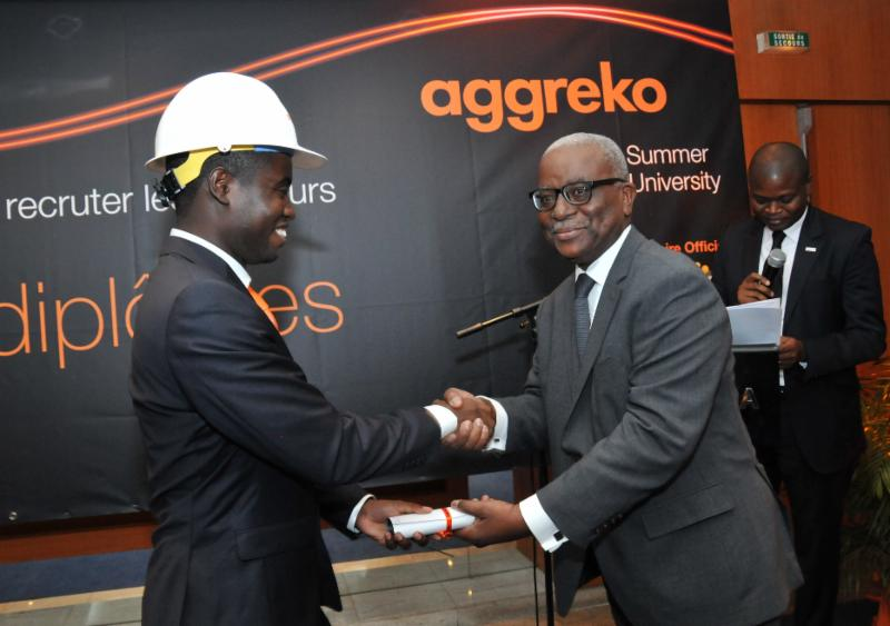 Joey Briam Mouton from DRC receives his diploma from the Operations Director of CI-Energies, Tanoe Bile