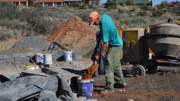 A white man labouring in Orania, South Africa All jobs are done by white people in Orania - no outside workers are brought in