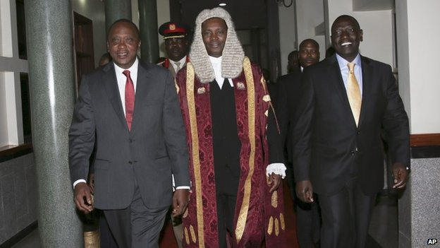 William Ruto (right) also faces charges at the Hague