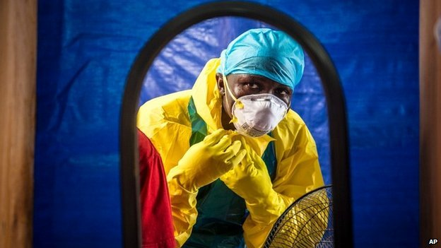 A medical worker dons protective gear before entering an Ebola treatment centre in Freetown, Sierra Leone - 16 October 2014 The World Health Organization is ramping up efforts to stop Ebola from spreading elsewhere in Africa