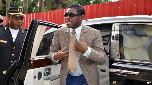Teodorin Nguema Obiang (R), the son of Equatorial Guinea's president Teodoro Obiang and the country's vice president in charge of security and defense, arrives at Malabo's Cathdral to celebrate his 41st birthday, June 25, 2013.