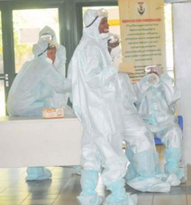 HEALTH PERSONNEL IN PROTECTIVE KITS AT THE NATIONAL HOSPITAL IN ABUJA ON TUESDAY