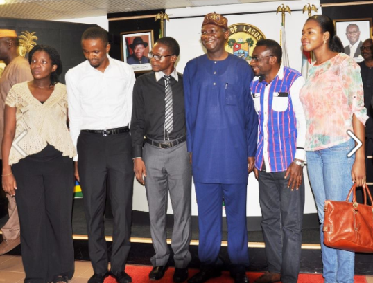 Gov. Babatunde Fashola of Lagos State poses with survivors of the Ebola virus