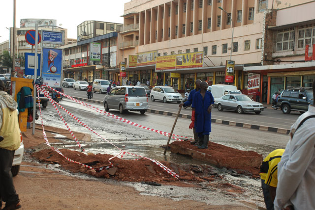 Know why our sewage pipes keep bursting? Workers of National Water and Sewerage Corporation (NWSC) yet another burst pipe on Jinja Road in Kampala. Photo: Wilfred Sanya