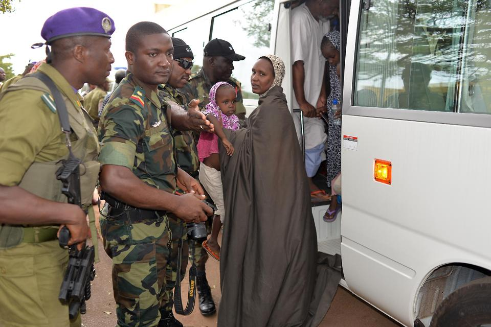 Cameroonian hostages, who were released to authorities after being kidnapped in raids blamed on the Nigerian Islamist group Boko Haram, arrive in Yaounde on October 11, 2014 (AFP Photo/Reinnier Kaze)