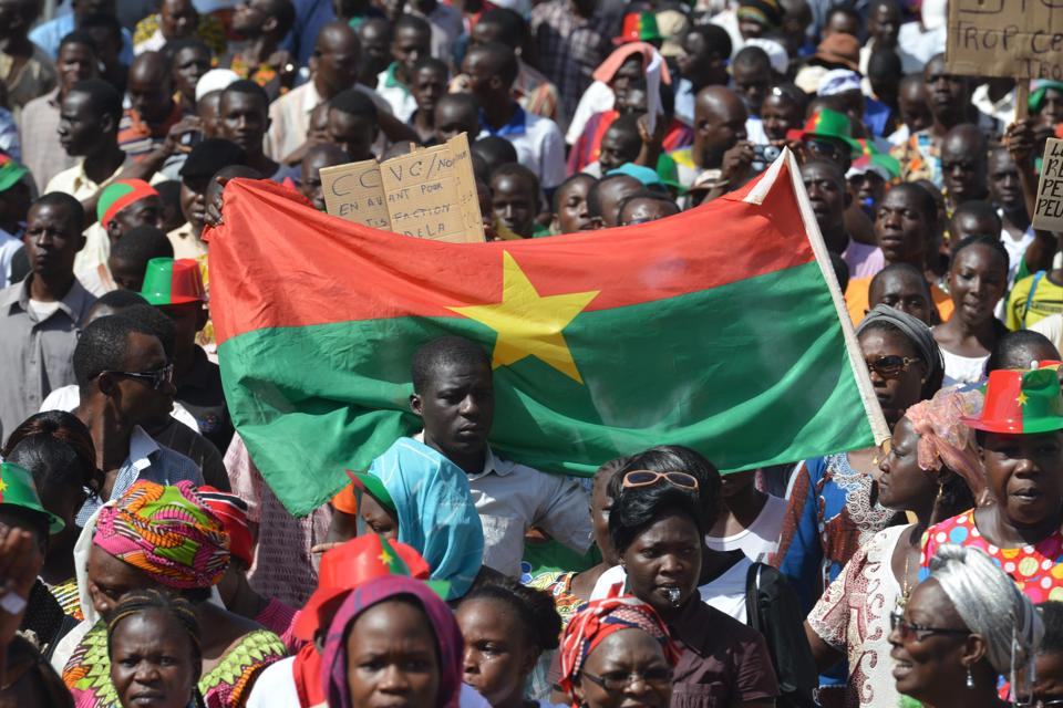 People on October 29, 2014 take part in a march in Ouagadougou (AFP Photo/Issouf Sanogo)