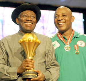 President Jonathan with the Afcon trophy pose with Super Eagles coach, Stephen Keshi at the reception