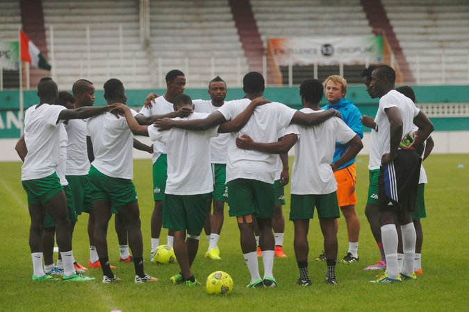 Sierra Leone's national team at a training session in Abidjan, Ivory Coast. The players continue to face reminders of the Ebola crisis. Credit Luc Gnago/Reuters