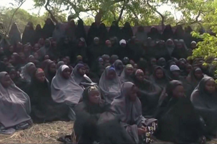 Boko Haram shows off 200 schoolgirls after they were abducted six months ago. Photo: AP