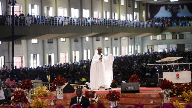 Bishop David Oyedepo (C), founder of the Living Faith Church, also known as the Winners' Chapel, conducts a service for worshippers in the auditorium of the church in Ota district, Ogun state, some 60 km (37 miles) outside Nigeria's commercial capital Lagos September 28, 2014. REUTERS/Akintunde Akinleye