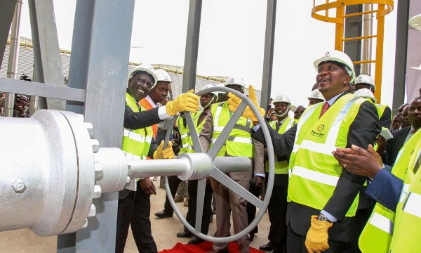 President Uhuru Kenyatta and Deputy President William Ruto unwind a turbine valve during the official Commissioning of the 140 Mega Watt Olkaria IV Geothermal Power Plant, in Naivasha Sub-county.